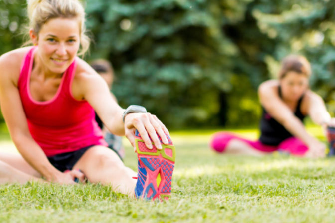 Ladies stretching during their exercise session in the morning.