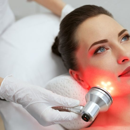 A female is having red light therapy from BCT medical associates